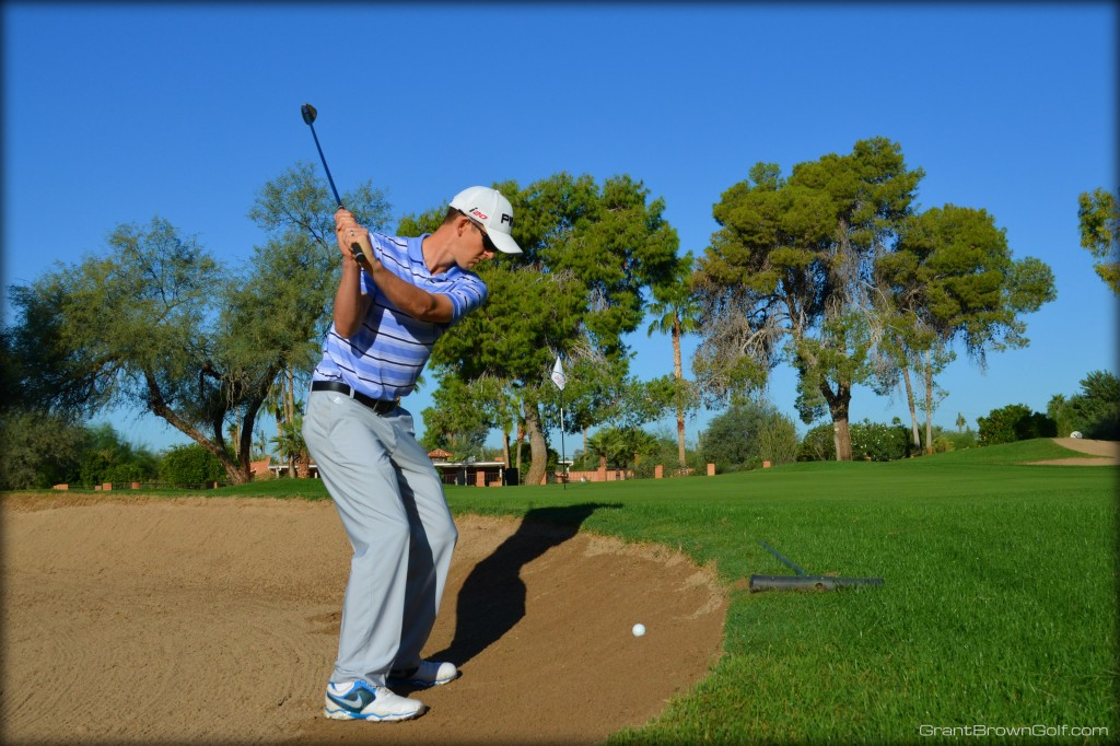 sand ball above top of backswing